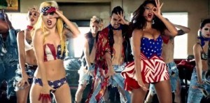 Dressed in American flags dancing over dead people making Satanic symbols. Subtlety!