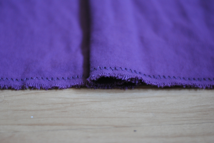Fold back so that there is a pleat with the inner fold along the centre line.